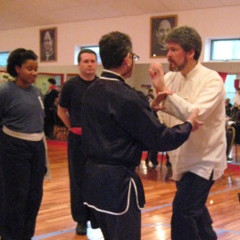 Sifu Dale explaining push hand rules at a Peaceful Dragon Team Tournament